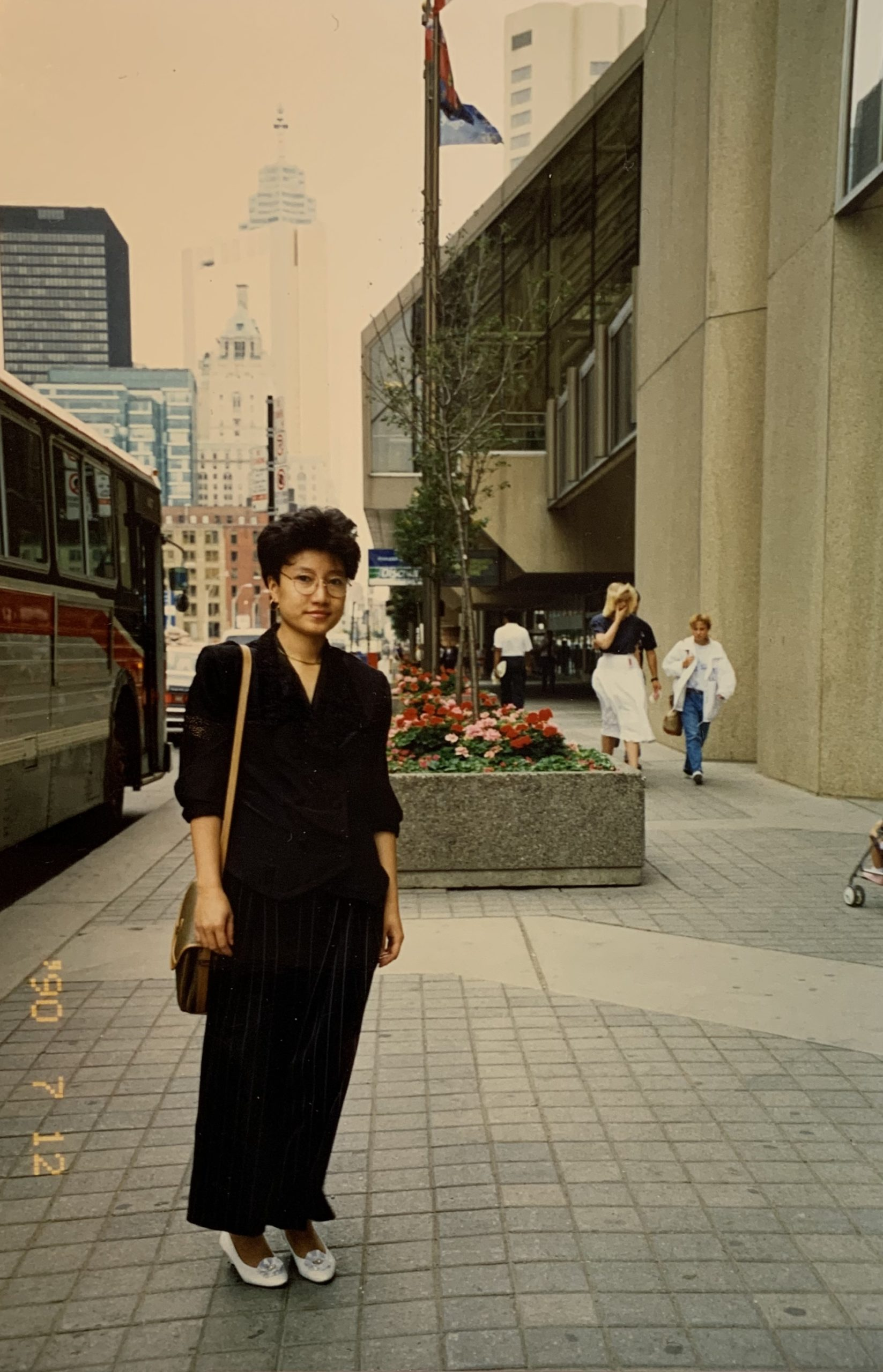photo of dr. suki hon's mom when she first arrived in toronto in the 90s near harbourfront